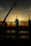 Construction silhouette. Silhouette of hardworking men on construction site Stock Images