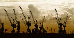 Construction silhouette of cranes on sunset  Stock Photography