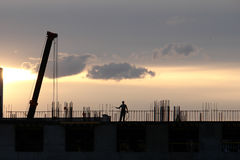 Construction silhouette in sunset Stock Images