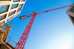 Construction Site. Red crane against blue sky Royalty Free Stock Photo