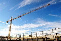 Construction site. Yellow crane in a construction site Royalty Free Stock Photo