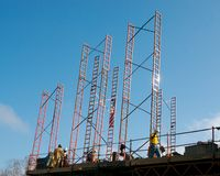 Construction site. A construction site with people on working with a blue sky background Royalty Free Stock Photography