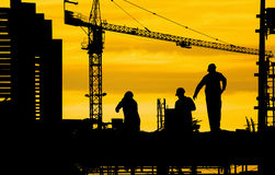 Construction site. Silhouette of construction site and worker Stock Photos