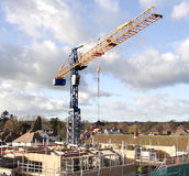 Construction Site. Crane and Construction Workers on a Building Site Constructing an Apartment Block Stock Image