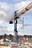 Construction Site. Crane and Construction Workers on a Building Site Constructing an Apartment Block Stock Photography