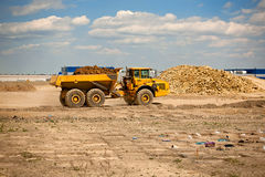 Construction site. Heavy machinery at factory construction site royalty free stock photo
