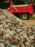 Construction site. Construction sire with red truck and pile of stones Stock Image