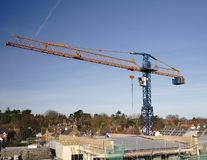 Construction Site. Crane on a Building Site Constructing an Apartment Block Stock Photos