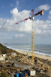Construction Site. High Rise crane at a construction site with sea view Stock Photo