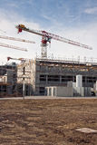 Construction site. With scaffolding building, tower crane and clear blue sky Stock Photos