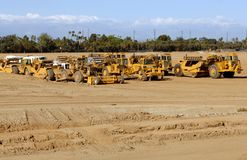 Construction Site. Earth Moving Equipment Parked After A Day of Work Royalty Free Stock Photos