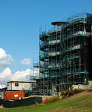 Construction site. A building under construction with scaffolding stock images