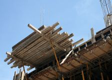 Construction site. Scaffolding with beams at construction site Royalty Free Stock Images
