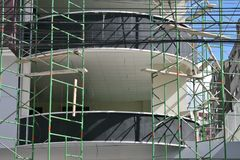 Construction site. Facade of a new building, with scaffolding Stock Photography
