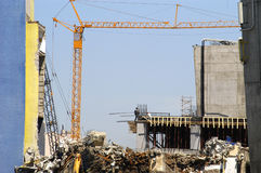 Construction site. Contruction site with crane, scaffolds, and piles of construction materials Stock Image