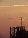 Construction site. Silhouette of the construction site at sunset Royalty Free Stock Image