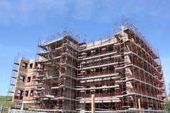 Construction Site. Concrete Highrise and Construction Site Stock Photo