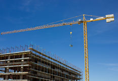 Construction Site. Concrete Highrise Construction site and Tower Crane Stock Image