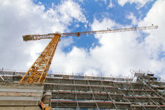 Construction site. Big construction site with yellow crane and cloudscape Royalty Free Stock Image