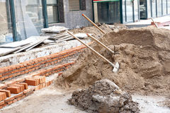 Construction site. Spades in gravel. Construction site in the city center Royalty Free Stock Image