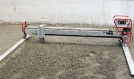 Construction site. Machine running screed flooring Royalty Free Stock Images