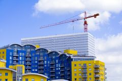 Construction site. A crane in a modern construction site Royalty Free Stock Image