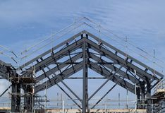 Construction site. Steel beams and girders forming the framework of a new building stock photos