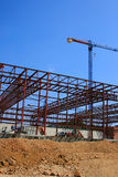 Construction site. New building structure and crane over blue sky Stock Photos