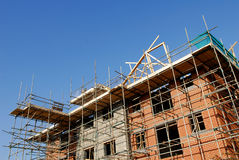 Construction site. Building site with new homes under build surrounded by scaffolding Royalty Free Stock Photography