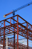 Construction site. New building structure and crane over blue sky Stock Image