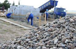 Construction site. Workers on a construction site with stones royalty free stock photography