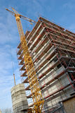 Construction site. With a yellow crane royalty free stock images