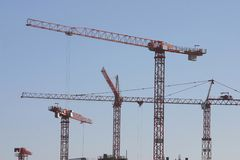 Construction site. Cranes stock photos