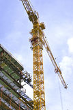 Construction site. Building and construction crane with sky on background royalty free stock images