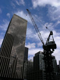 Construction site. Photo of urban construction site, showing crane and tall buildings stock photography