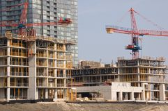 Construction site. Two crains on a new constraction site of high-rise building royalty free stock photos