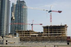 Construction site. Two crains on a new constraction site of high-rise building Royalty Free Stock Photo