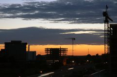 Construction site. In the metropolitan area at sunset Royalty Free Stock Photo