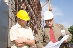 Construction site. Engineers at the cosnstruction site stock photo
