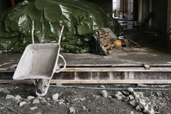 Construction site. A wheel barrow resting at a construction site royalty free stock photo