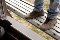 On the Construction Site. Feet on construction worker on scaffold stock image