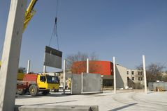 Construction site. Prefab concrete walls are placed into position Stock Image