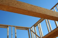 Construction site. Wood frame of a new house under construction Stock Photos