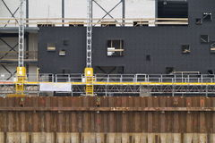 Construction site. A view of a steel retaining wall and equipment at a large construction site Royalty Free Stock Photo