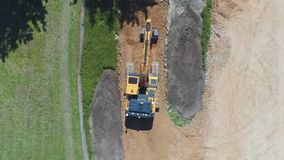 Excavator loader working on a construction site. Aerial footage. stock video footage