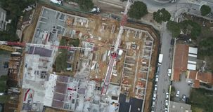 Construction site aerial view. Construction site with cranes in city aerial view stock footage