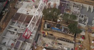 Construction site aerial view. Construction site with cranes in city aerial view stock video footage