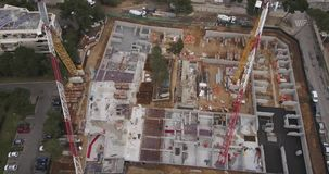 Construction site aerial view. Construction site with cranes in city aerial view stock video