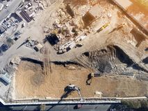 Construction Site Aerial View. Mall Building Base With Solid Concrete Pillars. Heavy Machinery Piling And High Tower Crane Working Royalty Free Stock Images