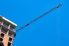 Construction site against the blue sky. Construction of a multi-storey building royalty free stock photography